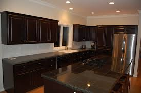 painted and stained kitchen cabinets paint or stain kitchen cabinets cabinet painting and staining
