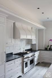 white kitchen cabinets with oak flooring kitchen with white oak floors transitional kitchen
