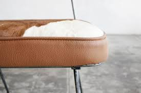 sold pair of 1950s hairpin side chairs in cowhide rehab