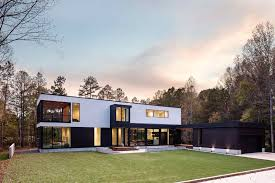 this new contemporary house surrounded by trees overlooks a
