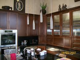 decorating kraftmaid cabinets in black and brown with stove and