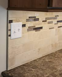 Schluter Strip Caps Off A Travertine Tile Backsplash In An Erie - Travertine tile backsplash