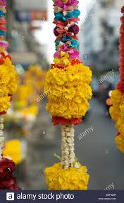 hindu garland a garland of marigold flowers hangs near a hindu temple in bangkok