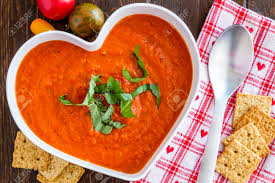 heart shaped crackers tomato and basil soup in white heart shaped bowl with