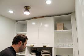 how to install cabinets with uneven ceiling how to trim out ikea cabinets chris