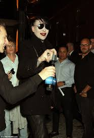 marilyn manson fits right in despite his lack of fancy dress as he