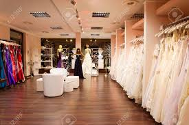 the bridal shop mannequins in wedding and evening gowns in the bridal shop stock