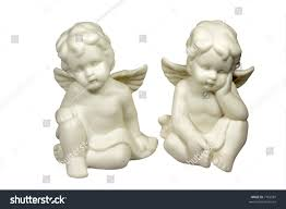 two ceramic little angels isolated on stock photo 7166581