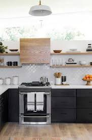 kitchen with black island and white cabinets 25 black white kitchen cabinet ideas sebring design build