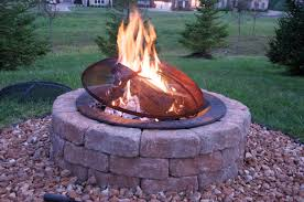 complete round stone fire pit designs with metal cover near green