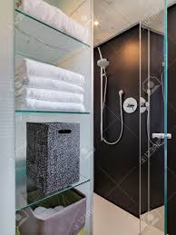 Bathroom Box White Towel And Box On The Glass Shelves Overlooking On Glass