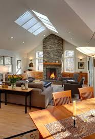 comfortable living room designed with stone fireplace and