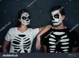Halloween Skeleton Faces by Loving Couple Skull Face Art Costume Stock Photo 214023277
