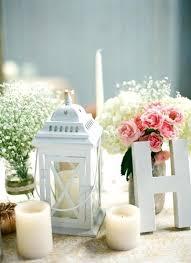 white lantern centerpieces lantern centerpiece ideas white and greenery wedding centerpieces