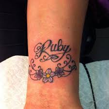 ruby lettering and flowers artoderm