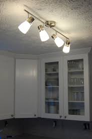 gray wall paint white wardrobe with glasses panel tracking lamps