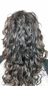 pretty v cut hairs styles best 25 long curly haircuts ideas on pinterest curly hair long