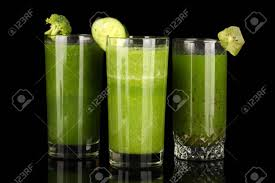 green drink three kinds of green juice isolated on black stock photo picture