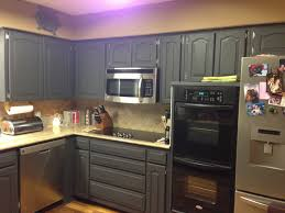 kitchen kitchen with dark gray chalk cabinet painting and rustic