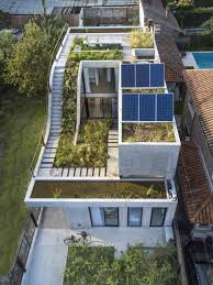 sustainable house built around a vertical garden digsdigs