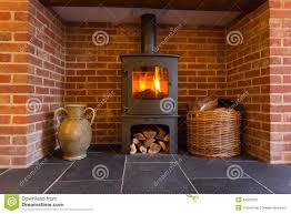 wood burning stove in brick fireplace stock image image 34502183