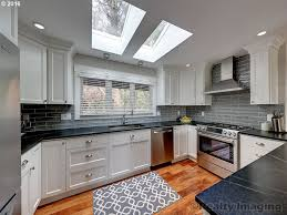 kitchen with skylight u0026 hardwood floors in portland or zillow