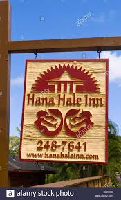 hana hale inn sign with bungalows by water in remote hana in maui