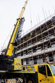terex ac 140 tonne compact mobile crane working construction in