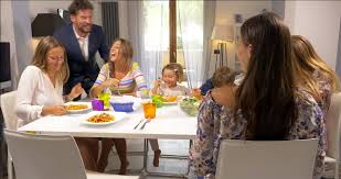 Kids Eating Table Father Coming From Work At Home Kissing Kids And Teenage Daughters