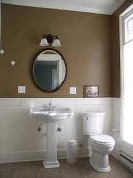 bathroom ideas with wainscoting earthy brown looks great with white fixtures pedestal sink and