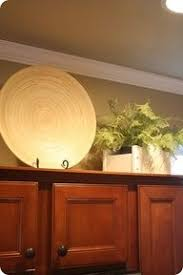 the 25 best above cabinet decor ideas on pinterest above