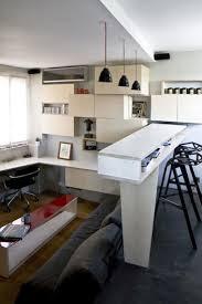 studio apartment design idea with modular shelving units and mini
