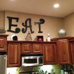 top of kitchen cabinet decorating ideas kitchen ideas for decorating above kitchen cabinets