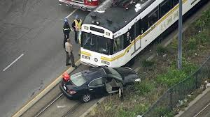 lexus service huntington beach driver hospitalized after colliding with blue line train in long