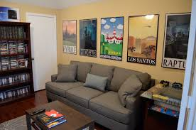 great posters lining the wall of this gaming room gaming rooms