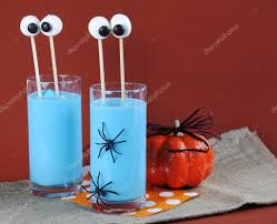halloween blue smoothie drink with funny marshmallow eyes u2014 stock