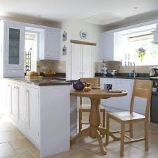 small kitchen diner ideas pale blue cabinets black counter tops and black appliances