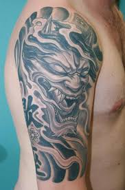 half sleeve asian demon tattoo design photos pictures and