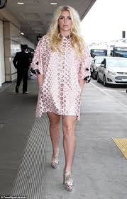 what to wear with a light pink dress kesha looks retro in light pink dress with gold daisies at la
