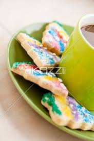 things that are green green cup of coffee colorful candies and