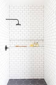 subway tiled shower ledge with black grout transitional bathroom