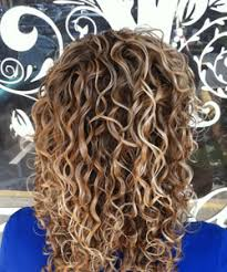 curly hair with lowlights hair color tips for vibrant summer curls naturallycurly com