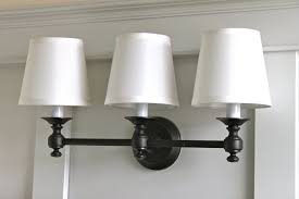 lighting ideas 3 lights oil rubbed bronze sconces with white