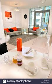 the living room and dining area in the manor mills show flat in