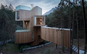 bengo studio joints multiple wooden rooms around a central