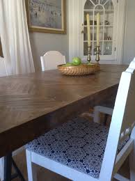 Door Dining Room Table by Creating A Herringbone Table From An Old Door And Paint Sticks