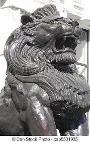 roaring lion statue closeup of roaring lion statue in front of building stock images