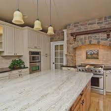 white kitchen cabinets with river white granite pin on florida room