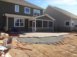 paver patio and bubbling rock in fort mill at springfield