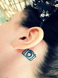 picture of tiny camera tattoo behind the ear